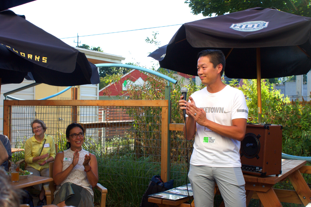 Board member speaks to other board members at annual mmeeting outdoors