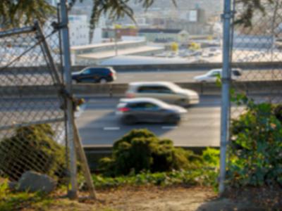 Freeway through broken gate